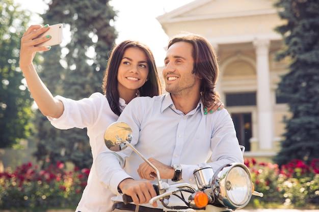 Cheerful couple making selfie photo