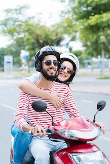Cheerful couple on scooter