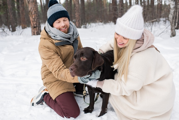 Cheerful couple with dog