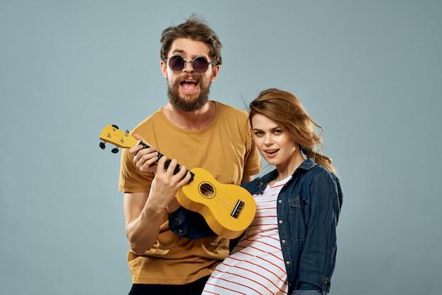 Cheerful couple with ukulele