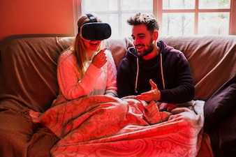 Cheerful couple with VR headset