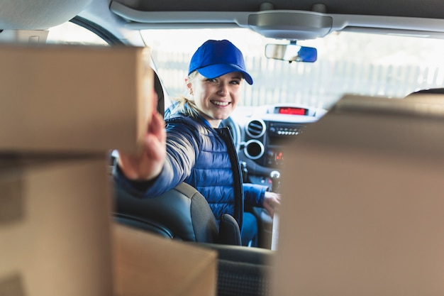 Cheerful courier in car