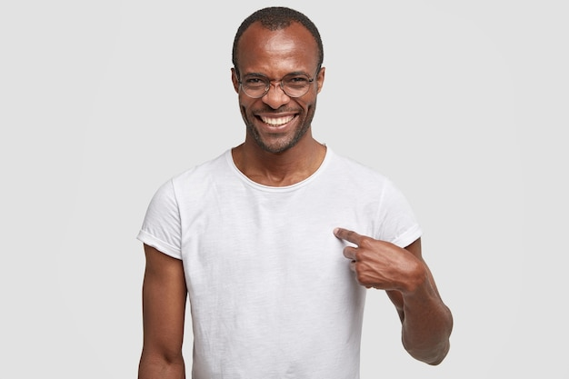 Cheerful dark skinned guy with toothy smile