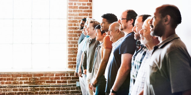 Cheerful diverse men standing in a row social banner