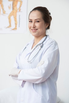 Cheerful doctor posing