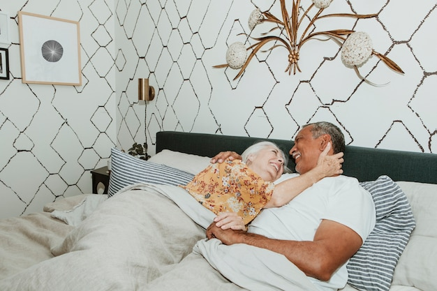 Cheerful elderly couple in a bed