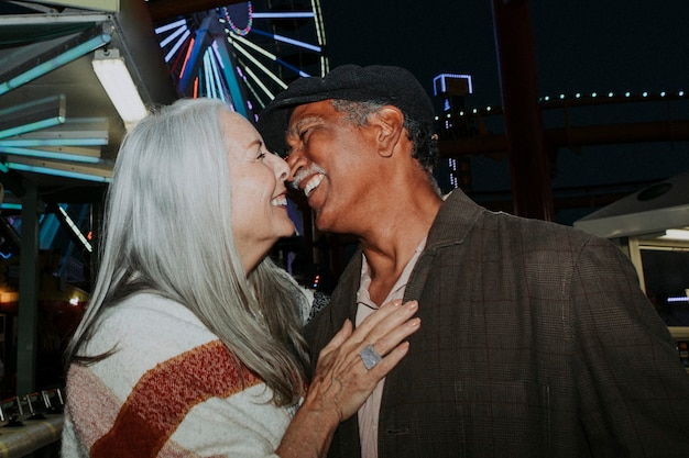 Cheerful elderly couple at pacific park in santa monica, california