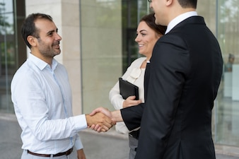 Cheerful entrepreneur greeting new business partner