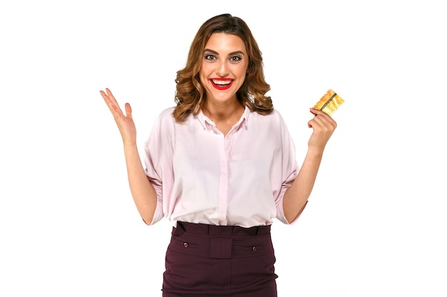 Cheerful excited surprised young woman with credit card