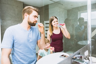 Cheerful family brushing teeth