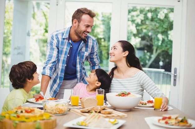 Cheerful family at dining table
