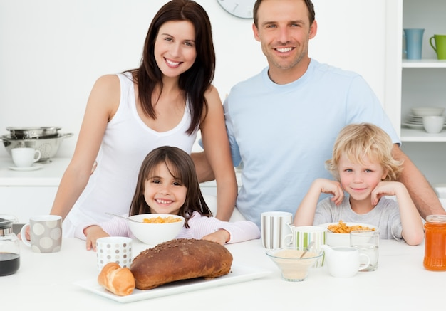 Cheerful family having breakfast together in the kitchen