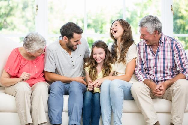 Cheerful family sitting on sofa