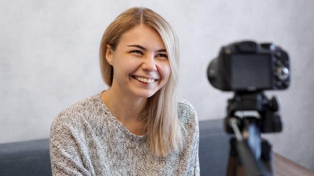 Cheerful female blogger recording video at home Premium Photo