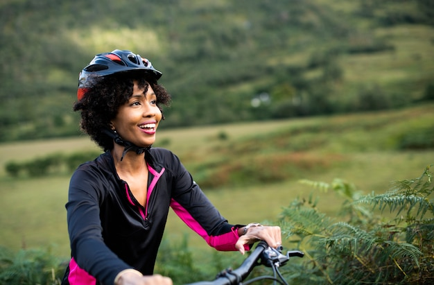 Cheerful female cyclist enjoying a bike ride