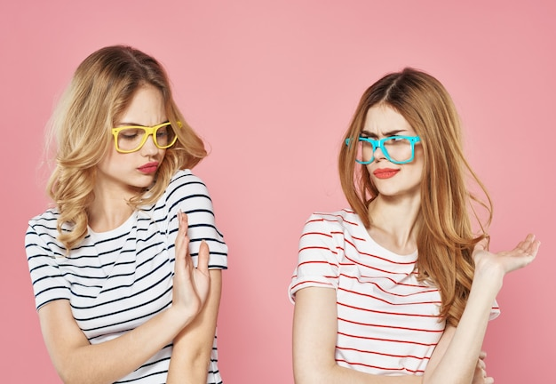 Cheerful female friends socializing lifestyle fun colorful glasses fashion