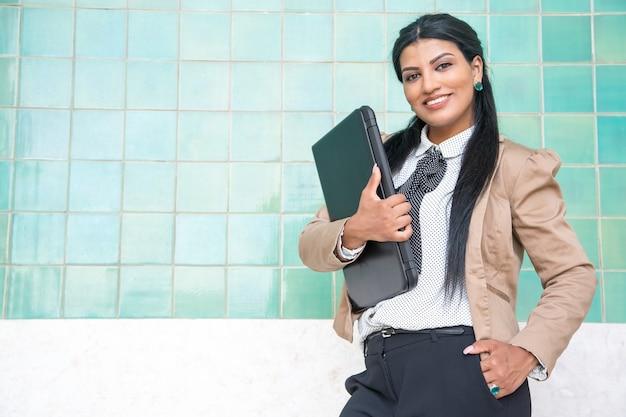 Cheerful female intern ready for work