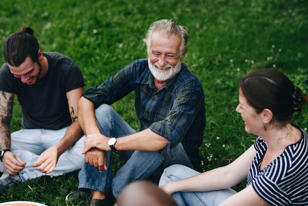 Cheerful friends having a conversation in the park