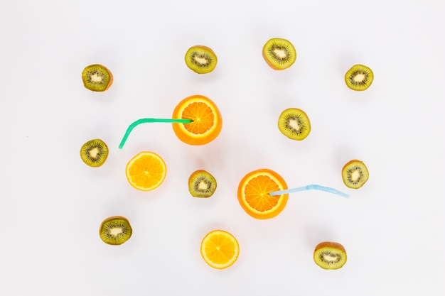 Cheerful friends oranges with tubules on a white background