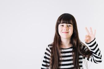 Cheerful girl gesturing OK