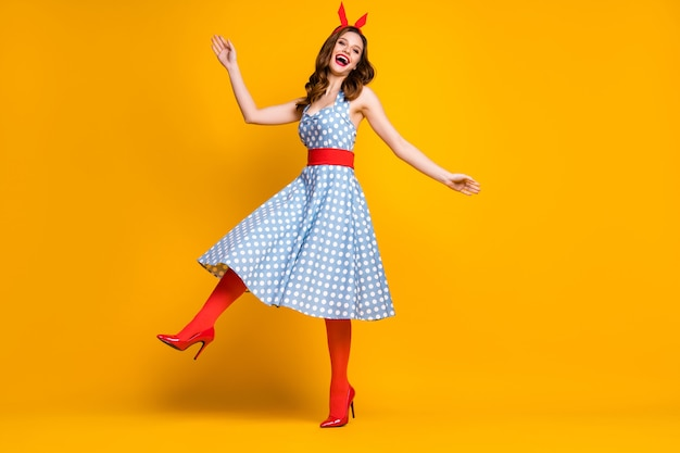 Cheerful girl moving having fun on bright background