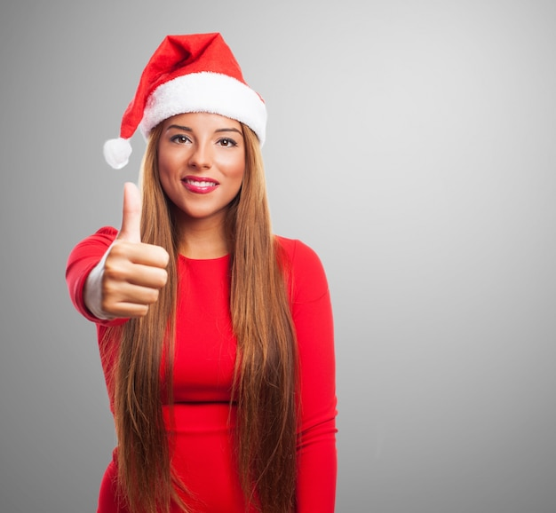 Cheerful girl showing a positive gesture