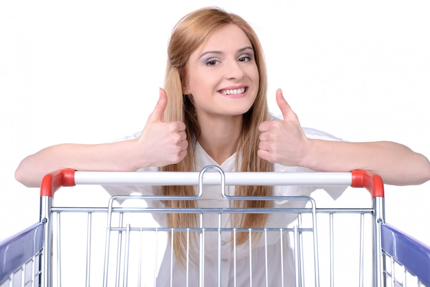 Cheerful girl shows thumbs up and smiles.