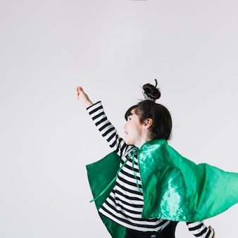 Cheerful girl in superhero costume