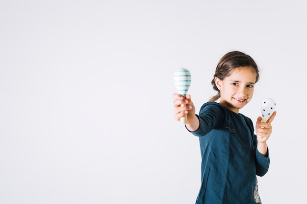 Cheerful girl with shakers