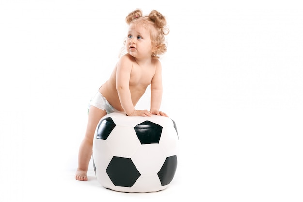Cheerful girl with a soccer ball