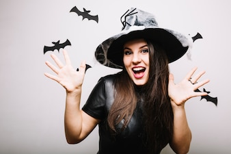 Cheerful girl with spooky party hat
