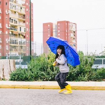 Cheerful girl with umbrella
