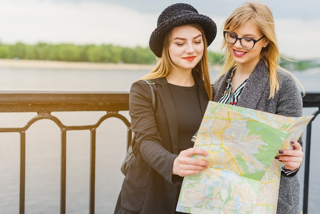 Cheerful girls with map