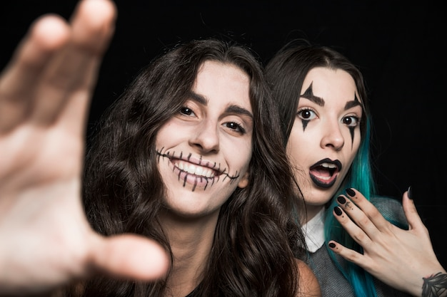 Cheerful girls with spooky makeup