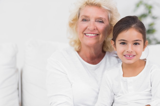 Cheerful granddaughter and grandmother portrait