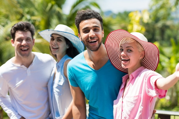 Cheerful group of people making selfie photo portrait happy smiling mix race man and woman making se