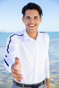 Cheerful guy posing outdoors