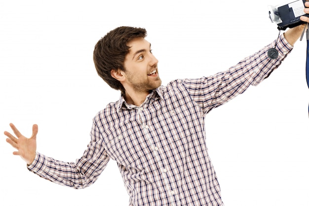 Cheerful guy record blog, himself on video camera