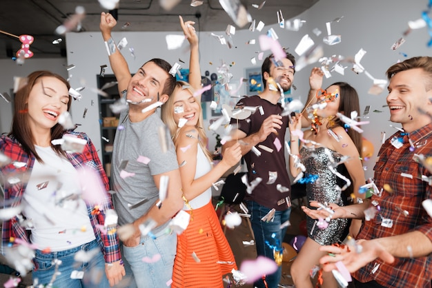 Cheerful guys in party. birthday party in confetti.