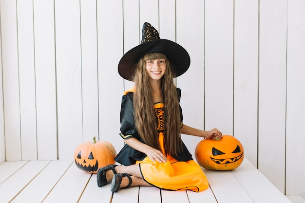 Cheerful halloween witch with jack-o-lanterns