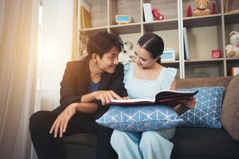 Cheerful Happy couple relaxing in sofa at home