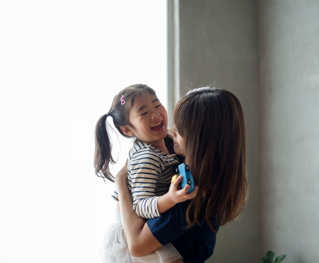 Cheerful japanese mother and daughter