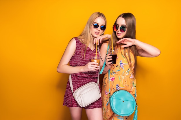 Cheerful ladies with drinks