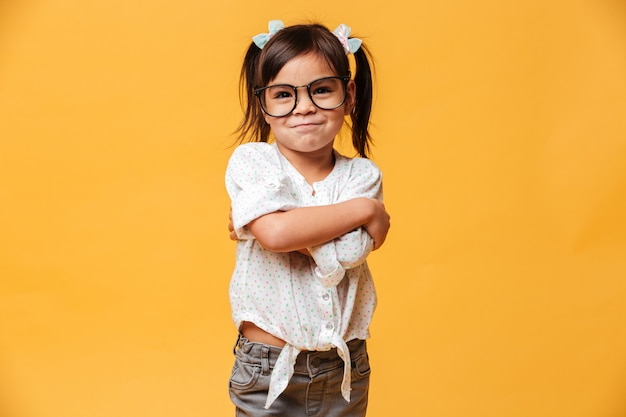 Cheerful little girl child wearing glasses