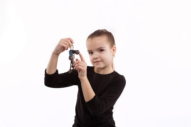 Cheerful little girl holding the keys