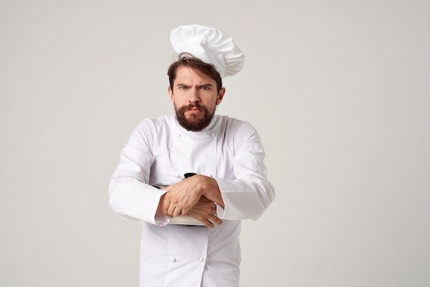 Cheerful male chef with a pan in the hands of a professional cooking food