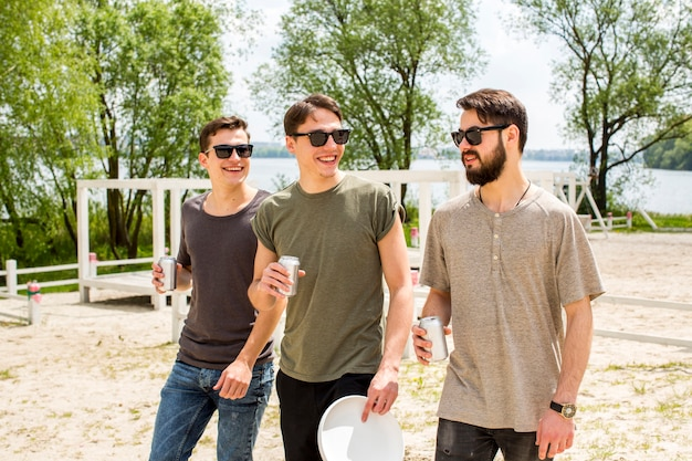 Cheerful male friends drinking beer Free Photo