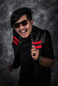 Cheerful man in black leather jacket
