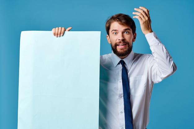 Cheerful man blue banner copyspace advertising presentation closeup