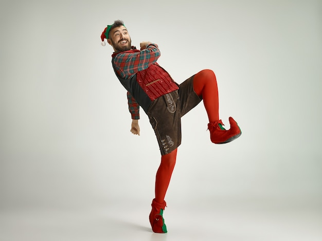 Cheerful man in elf costume in motion
